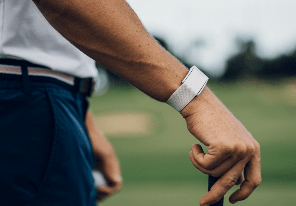 Justin Thomas wearing his Whoop on a golf course